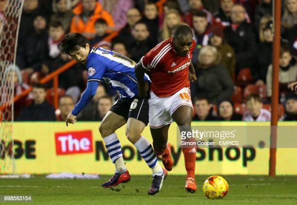 Nottingham Forest's Michail Antonio and Wigan Atheltic's Kim BoKyung battle for the ball