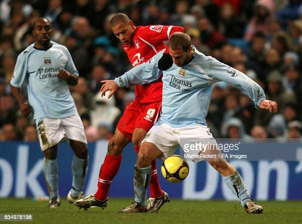 Nottingham Forest's Nathan Tyson and Manchester City's Pablo Zabaleta battle for the ball
