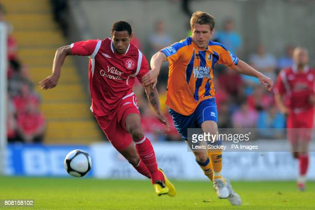 Nottingham Forest's Nathan Tyson and Mansfield Town's Kevin Sandwith battle for the ball