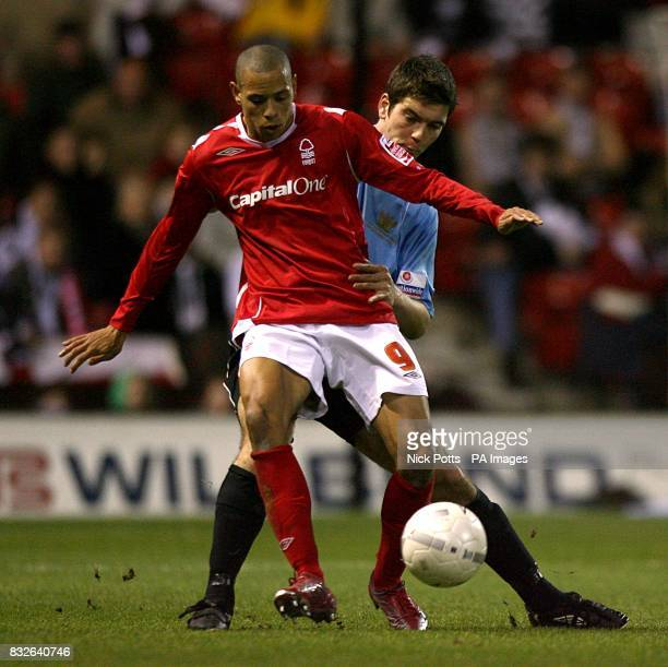 Nottingham Forest's Nathan Tyson and Salisbury City's Timothy Bond