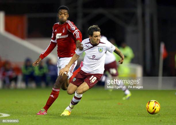 Nottingham Forest's Nathaniel Chalobah battles with Burnley's Danny Ings during the Sky Bet Championship match at The City Ground Nottingham