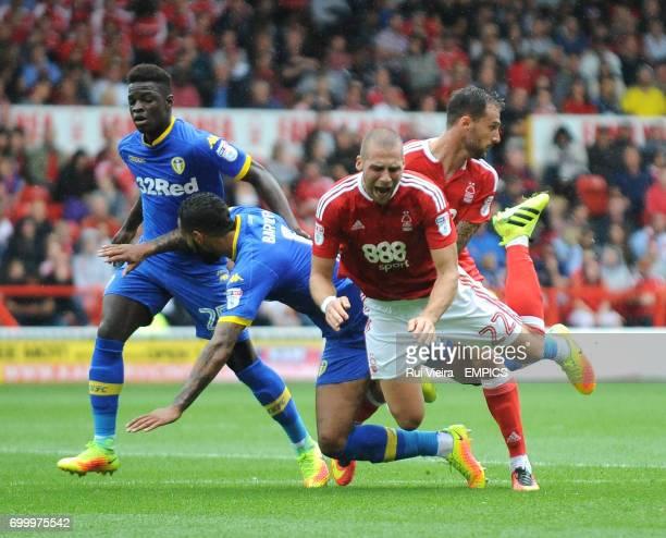 Nottingham Forest's Pajtim Kasami tacked by Leeds United's Kyle Bartley