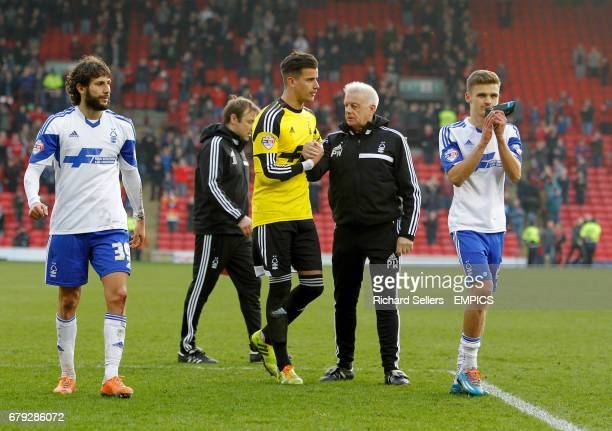 Nottingham Forest's players Djamel Abdoun left Karl Darlow centre and Jamie Patterson right walk off after losing the match