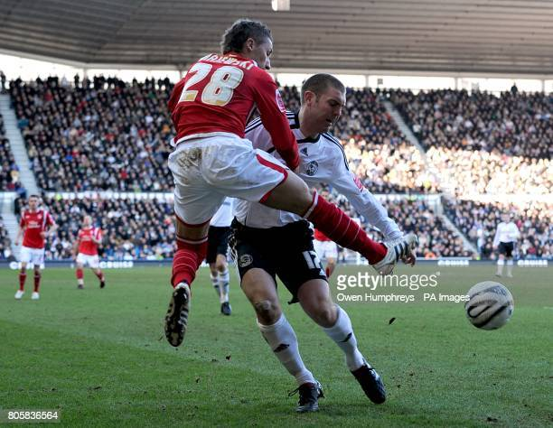 Nottingham Forest's Radoslaw Majewski and Derby County's Jake Buxton in action