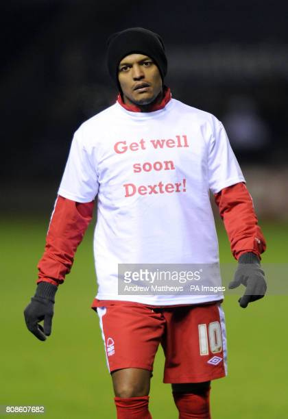 Nottingham Forest's Robert Earnshaw wears a tshirt saying 'Get Well Soon Dexter' in the warm up during npower Championship match at the Walkers...