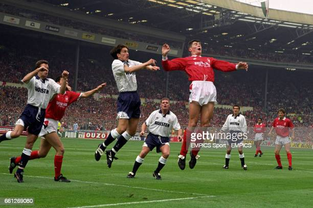 Nottingham Forest's Roy Keane and Steve Chettle and Tottenham Hotspur's Justin Edinburgh and David Howells leap for the ball at a corner watched by...