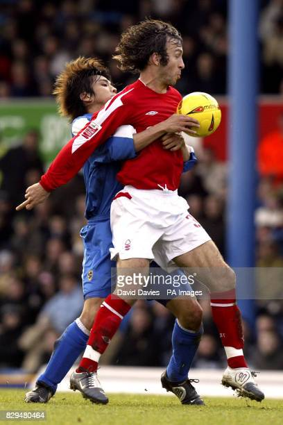 Nottingham Forest's Shaun Derry is challenged by Cardiff City's Junichi Inamoto