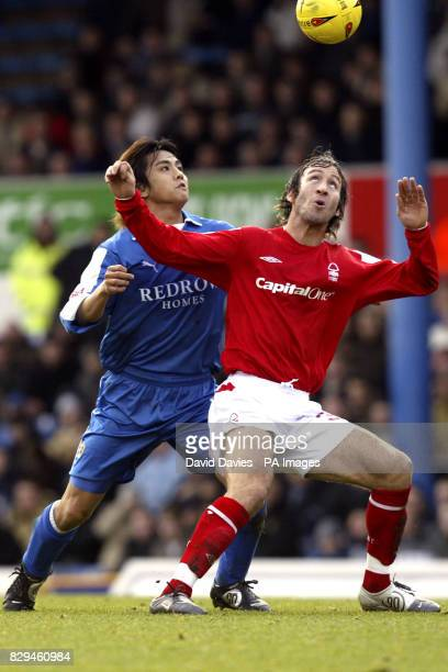 Nottingham Forest's Shaun Derry is challenged by Junichi Inamoto of Cardiff City THIS PICTURE CAN ONLY BE USED WITHIN THE CONTEXT OF AN EDITORIAL...