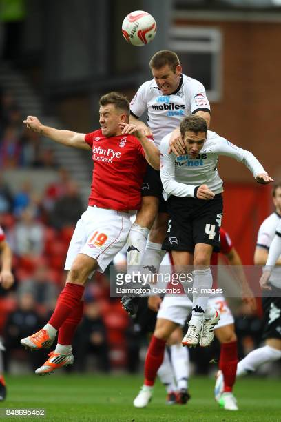 Nottingham Forest's Simon Cox and Derby County's Jake Buxton and Craig Bryson battle for the ball during the npower Football League Championship...
