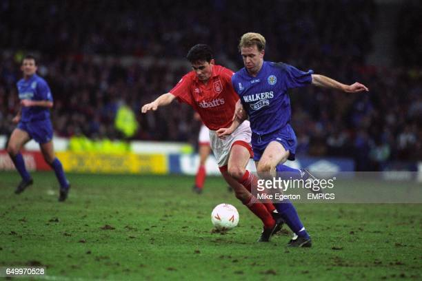 Nottingham Forest's Steve Chettle and Leicester City's David Oldfield battle for the ball