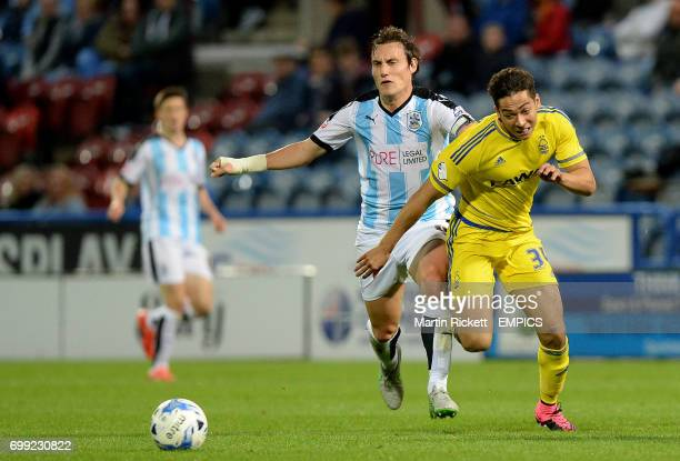 Nottingham Forest's Tyler Walker battles for the ball with Huddersfield Town's Dean Whitehead