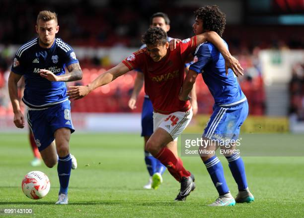 Nottingham Forest's Tyler Walker grapples with and Cardiff's Fabio