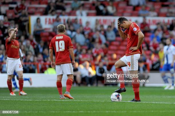 Nottingham Forest's Tyler Walker stands dejected as his side concede their second goal of the game
