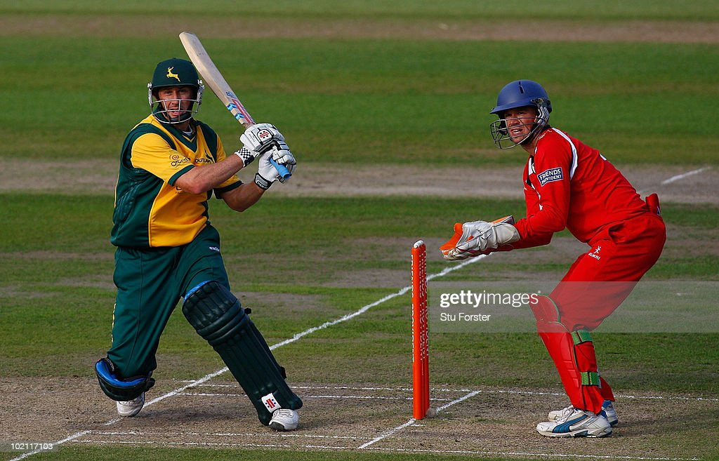 Nottinghamshire batsman David Hussey hits out watched by Lancashire wicketkeeper Gareth Cross during the Friends Provident T20 match between Nottinghamshire and Lancashire at Trent Bridge on June 15, 2010 in Nottingham, England.