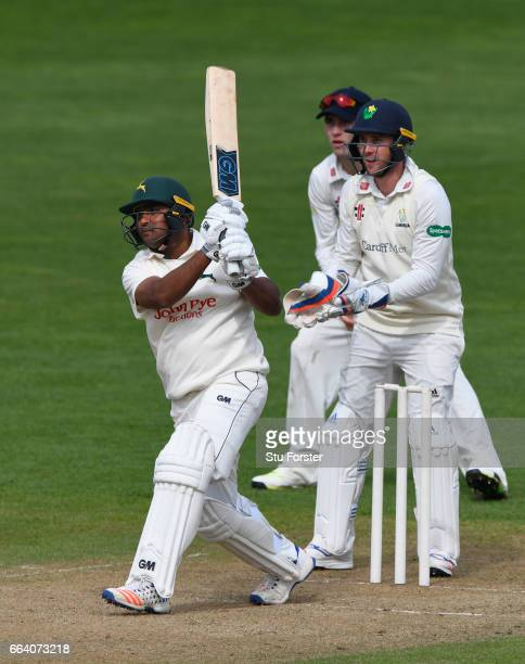 Nottinghamshire batsman Samit Patel hits out watched by wicketkeeper Chris Cooke during a pre season friendly between Glamorgan and Nottinghamshire...