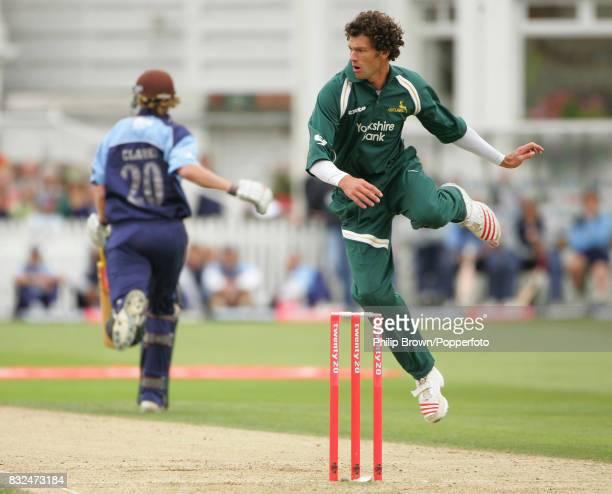 Nottinghamshire bowler Charlie Shreck avoids a return throw as Surrey batsman Rikki Clarke takes a run during the Twenty20 Cup Semi Final between...