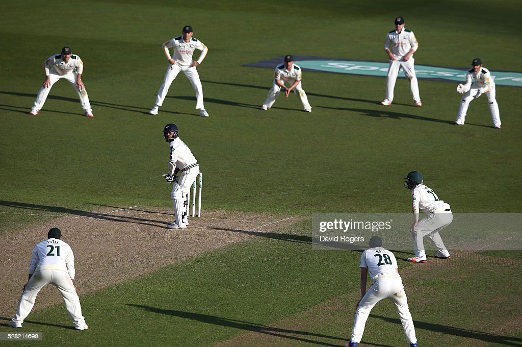 Nottinghamshire fielders surround <a gi-track='captionPersonalityLinkClicked' href=/galleries/search?phrase=Adil+Rashid&family=editorial&specificpeople=870228 ng-click='$event.stopPropagation()'>Adil Rashid</a> during the Specsavers County Championship division one match between Nottinghamshire and Yorkshire at Trent Bridge on May 4, 2016 in Nottingham, England.