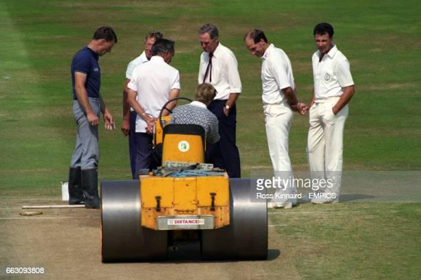 Nottinghamshire groundsman Ron Allsopp inspects the ground with team captains Derbyshire's Kim Barnett and Nottinghamshire's Tim Robinson
