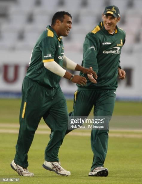 Nottinghamshire Outlaw's bowler Samit Patel celebrates with David Hussey after fielder Steven Mullaney catches Warwickshire Bears batsman Jim...