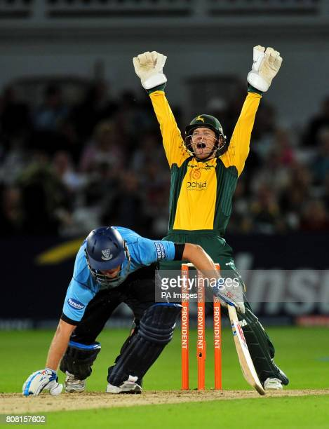 Nottinghamshire Outlaws' wicketrkeeper Chris Read celebrates after Sussex Sharks' Chris Nash is trapped lbw from the bowling of Samit Patel during...