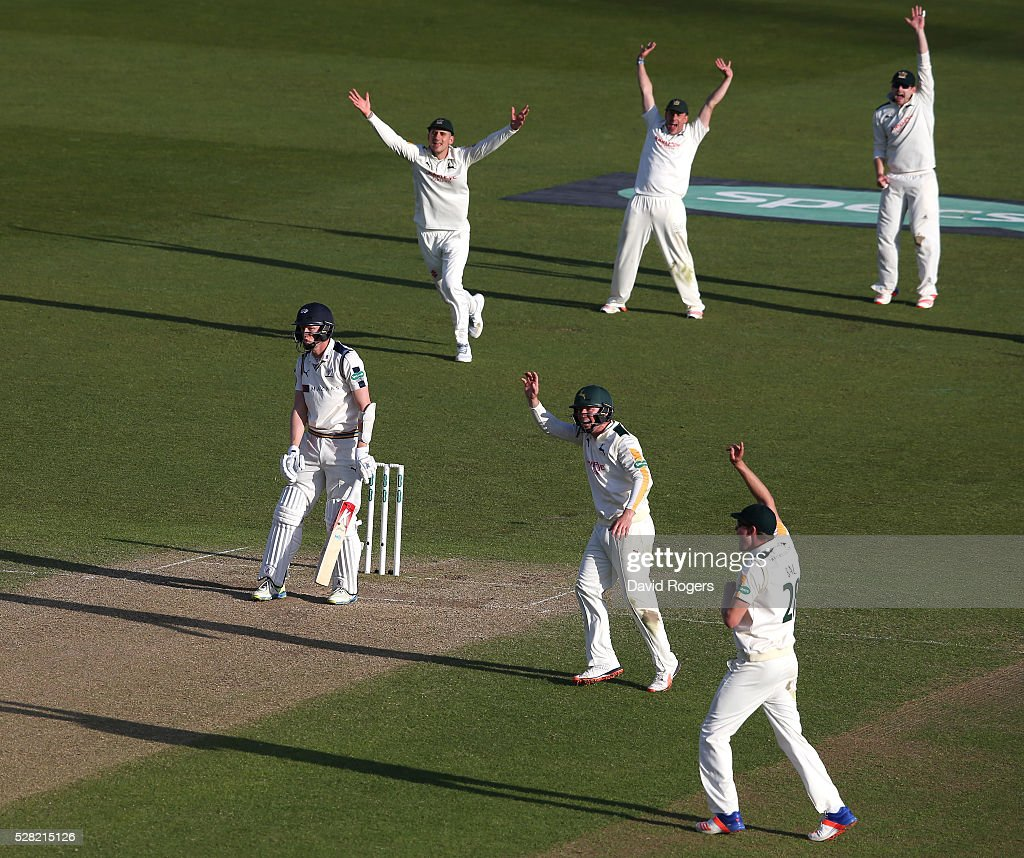 Nottinghamshire players celebrate after <a gi-track='captionPersonalityLinkClicked' href=/galleries/search?phrase=Steven+Patterson+-+Cricket+Player&family=editorial&specificpeople=15562678 ng-click='$event.stopPropagation()'>Steven Patterson</a> is trapped LBW off the bowling of Stuart Broad during the Specsavers County Championship division one match between Nottinghamshire and Yorkshire at Trent Bridge on May 4, 2016 in Nottingham, England.
