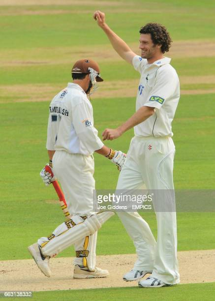 Nottinghamshire's Charlie Shreck celebrate the wicket of Surrey's Mark Ramprakash
