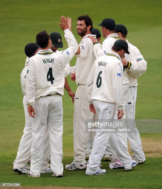 Nottinghamshire's Charlie Shreck celebrates taking the wicket of Warwickshire's Varun Chopra with his team mates