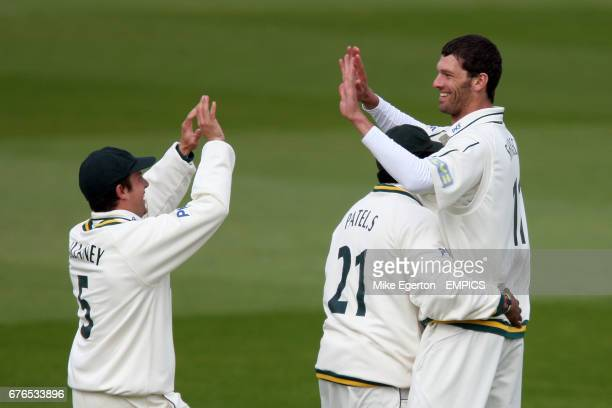 Nottinghamshire's Charlie Shreck celebrates the wicket of Durham's Will Smith with team mates Patel and Steven Mullaney