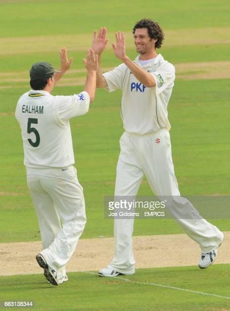 Nottinghamshire's Charlie Shreck celebrates with Mark Ealham after taking the wicket of Surrey's Mark Ramprakash
