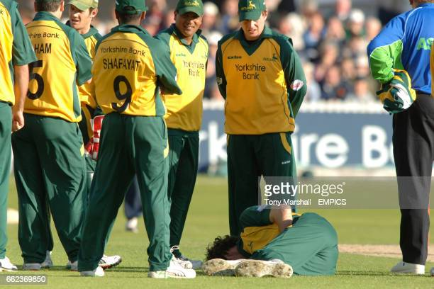 Nottinghamshire's Charlie Shreck lies injured after being hit by Derbyshire's Michael Dighton during the Twenty20 Cup match at Trent Bridge Nottingham