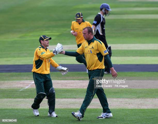 Nottinghamshire's Chris Read congratulates Luke Fletcher after dissmissing Nottinghamshire's William Porterfield during the t20 Group match at...