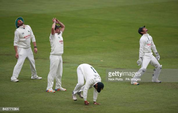 Nottinghamshire's Chris Read Rikki Wessels and Steven Mullaney show their dejection after Cheteshwar Pujara drops a catch from Worcestershire's...