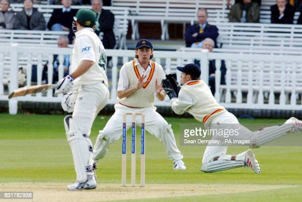 Nottinghamshire's David Hussey is drop by Marylebone's wicketkeeper Steven Davies during the County Champions match at Lords London
