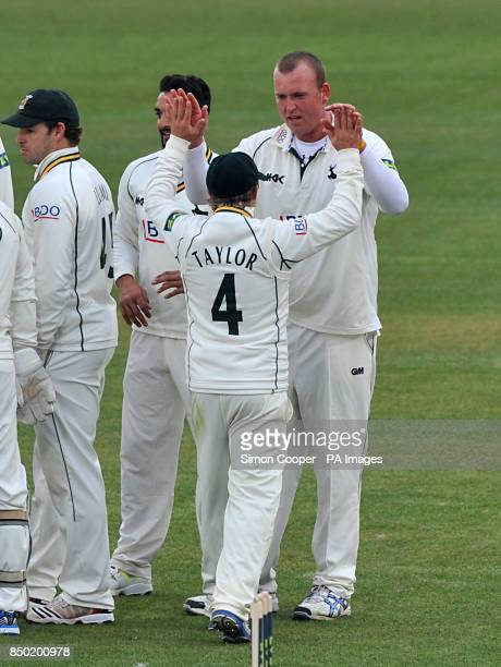 Nottinghamshire's Luke Fletcher celebrates taking the wicket of Middlesex's Gareth berg with teammate James Taylor during the LV=County Championship...