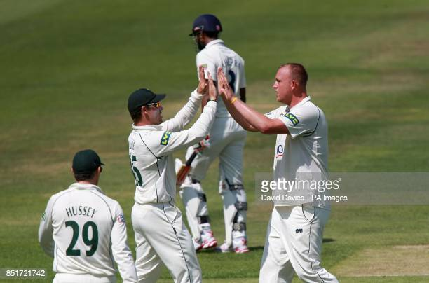 Nottinghamshire's Luke Fletcher celebrates taking the wicket of Warwickshire's Varun Chopra with Michael Lumb during the LV=County Championship...