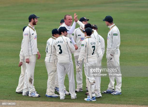 Nottinghamshire's Luke Fletcher celebrates with teammates after taking the wicket of Middlesex's Joe Denly during the LV=County Championship Division...