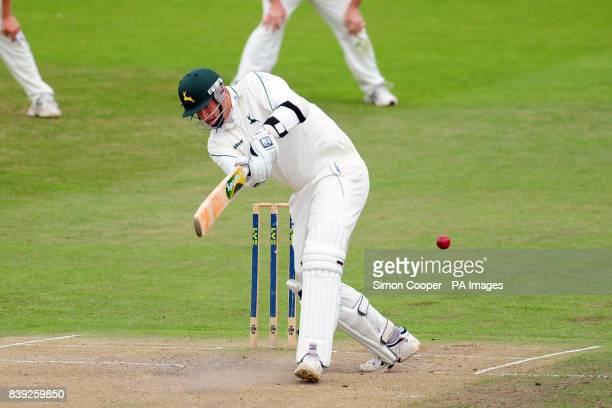 Nottinghamshire's Luke Fletcher hits out during the LV County Championship match at Trent Bridge Nottingham