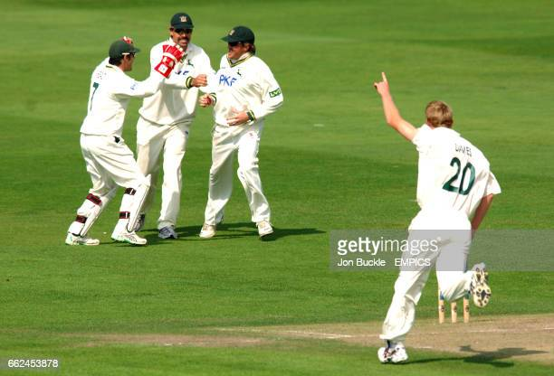 Nottinghamshire's Mark Davies celebrates claiming the wicket of Northamptonshire's Lance Klusener with teamates Graeme SwannChris Read and Stephen...