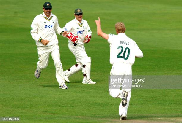 Nottinghamshire's Mark Davies celebrates claiming the wicket of Northamptonshire's Robert White with teamates Chris Read and Stephen Fleming