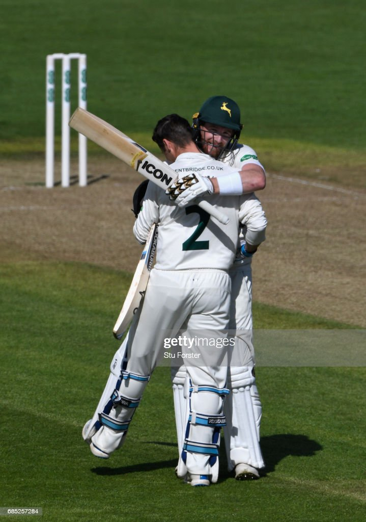 Notts batsman Jake Libby celebrates his century with batting partner Riki Wessels (r) during Day One of the Specsavers County Championship Divsion Two match between Glamorgan and Nottinghamshire at SWALEC Stadium on May 19, 2017 in Cardiff, Wales.