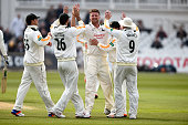 Notts bowler Jackson Bird celebrates with team mates after taking the wicket of Surrey batsman Rory Burns during Day two of the Specsavers County...