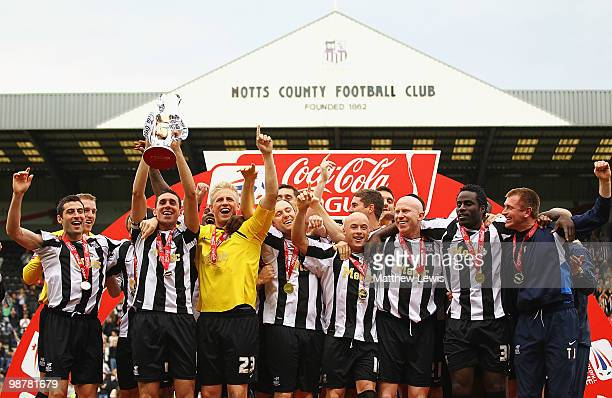Notts County celebrate winning the CocaCola League Two Championship after the CocaCola League Two match between Notts County and Cheltenham Town at...
