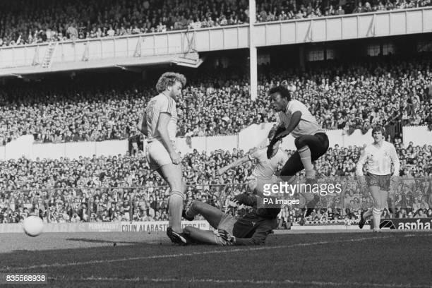 Notts County goalkeeper Raddy Avramovic saves from the feet of Tottenham Hotspur's Garth Crooks as Notts County's Brian Kilcline and Tottenham...