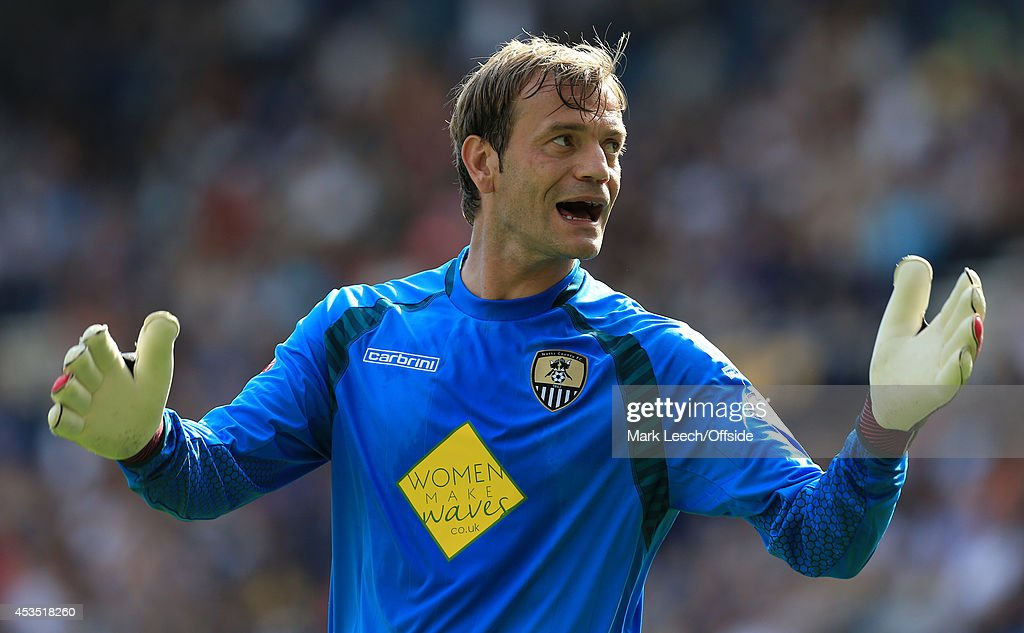 Notts County goalkeeper <a gi-track='captionPersonalityLinkClicked' href=/galleries/search?phrase=Roy+Carroll&family=editorial&specificpeople=206286 ng-click='$event.stopPropagation()'>Roy Carroll</a> looks dejected during the Sky Bet League One match between Preston North End and Notts County at Deepdale on August 9, 2014 in Preston, England.