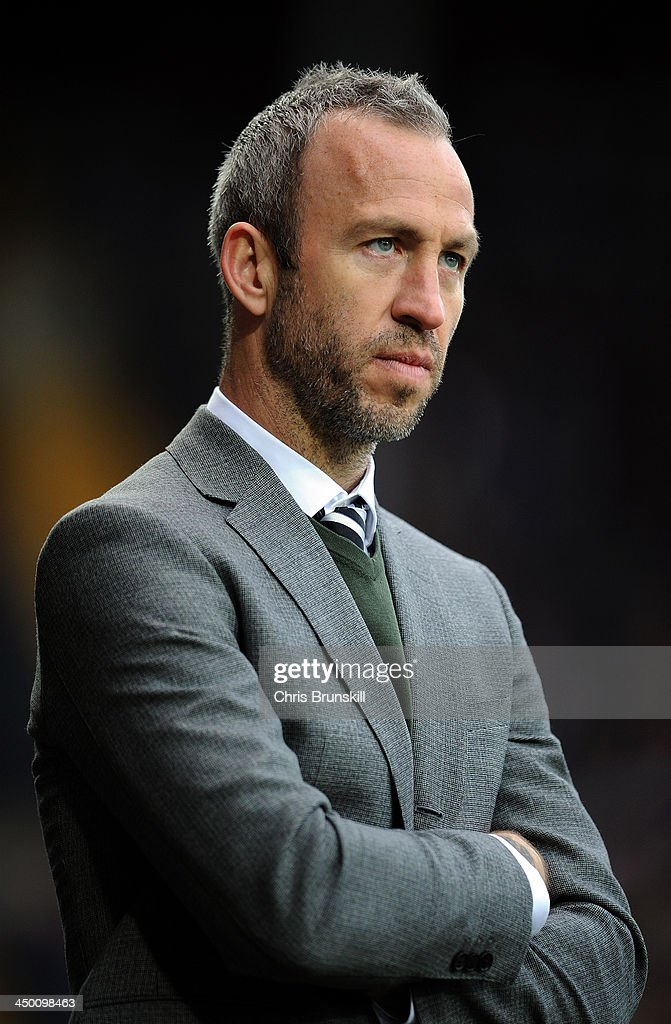 Notts County manager <a gi-track='captionPersonalityLinkClicked' href=/galleries/search?phrase=Shaun+Derry&family=editorial&specificpeople=235813 ng-click='$event.stopPropagation()'>Shaun Derry</a> looks on during the Sky Bet League One match between Notts County and Wolverhampton Wanderers at Meadow Lane on November 16, 2013 in Nottingham, England.