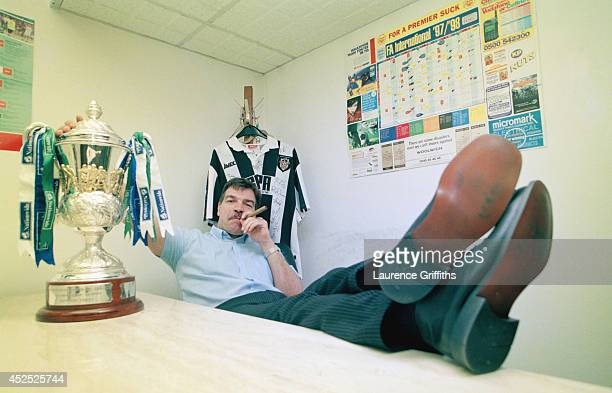 Notts County mananger Sam Allardyce celebrates the clubs success for the 199798 season with a cigar and the League trophy at Meadow Lane on May 1...