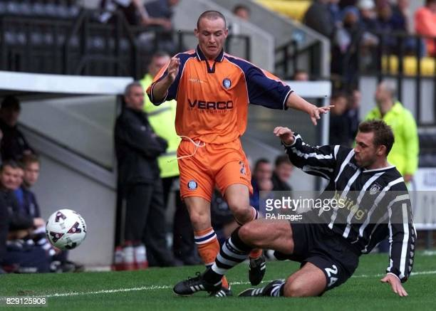 Notts County's Darren Caskey tackles Wycombe Warrior's Michael Simpson during the Nationwide Division Two match at the County Ground Meadow Lane...