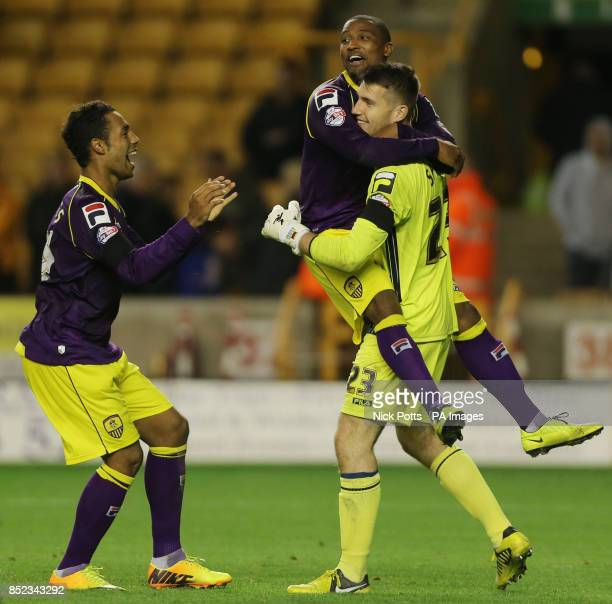 Notts County's goalkeeper Fabien Spiess celebrates victory with teammates after saving the final spot kick from Wolverhampton Wanderers' James Henry...