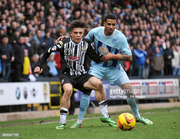 Notts County's Jack Grealish and Coventry City's Cyrus Christie battle for the ball during the Sky Bet League One match at Meadow Lane Nottingham