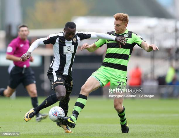Notts County's Jonathan Forte and Forest Green Rovers Mark Roberts during the match at Meadow Lane Nottingham